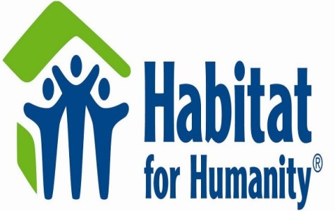UIS helps build 100th home with Habitat for Humanity
