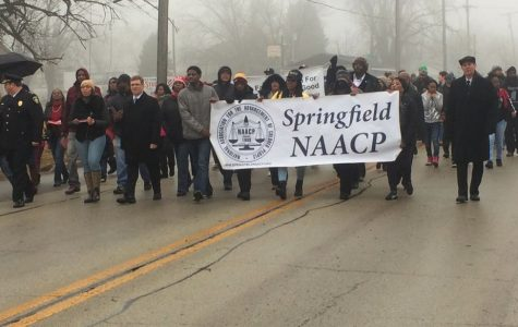 UIS volunteers, marches for Martin Luther King