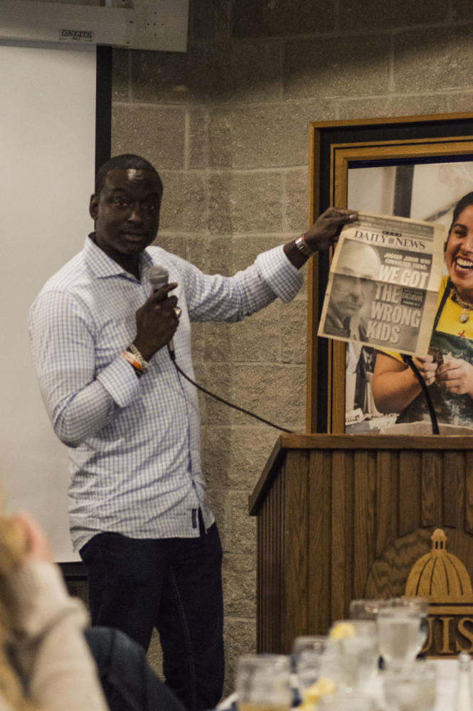 Salaam shows a front page from after his exoneration