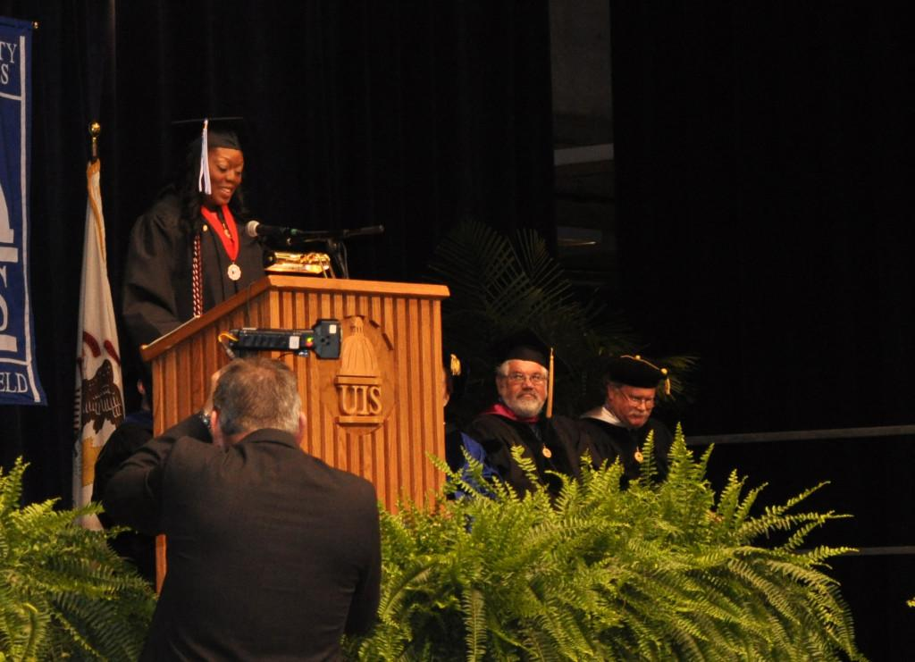 Jessica+Odigie%2C+UIS+graduate+of+2012%2C+delivers+her+student+commencement+address.