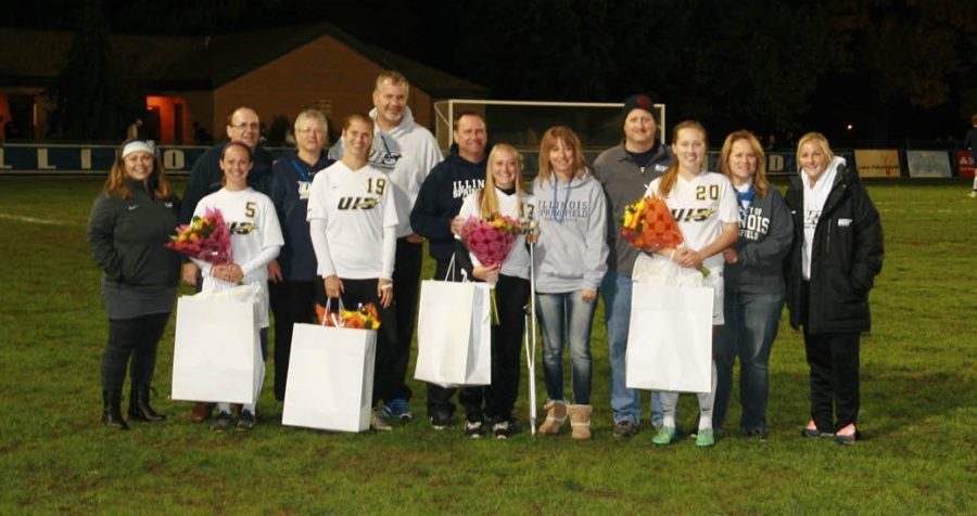 Alena Miller, Madisyn Coudriet, Sam Boettjer, and Alena Eitenmiller are honored with flowers during Senior Night.