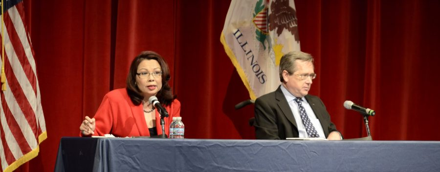 Tammy+Duckworth+and+Mark+Kirk+debate+in+the+UIS+Sangamon+Auditorium.
