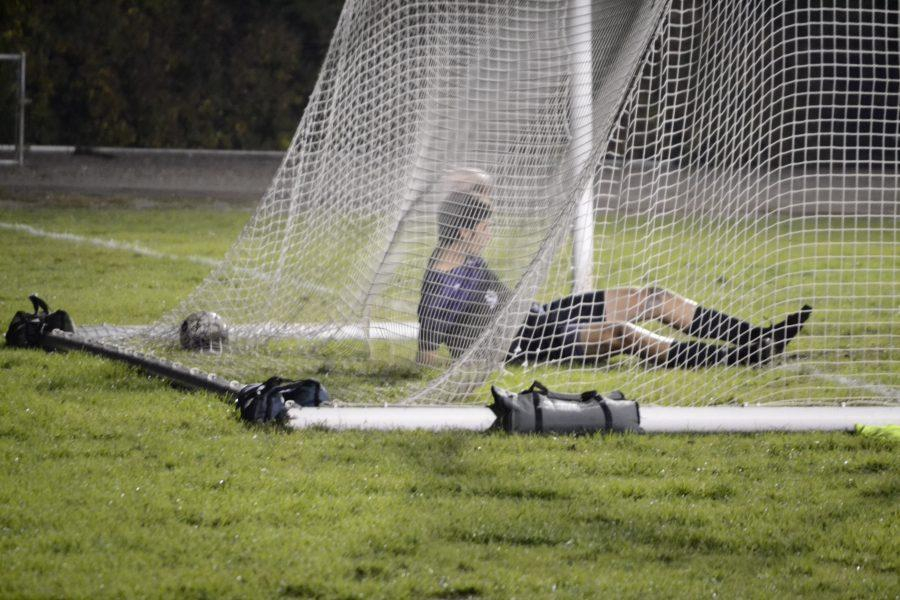 A McKendree goalkeeper collapses after a goal is scored against him