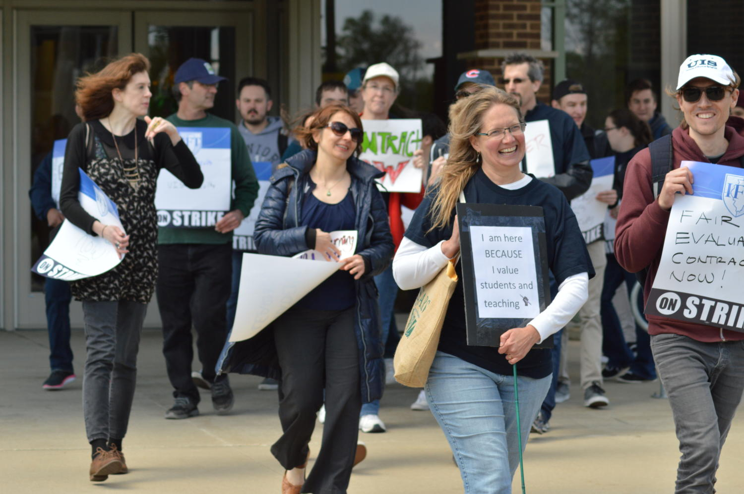 UIS faculty and supporters demonstrate outside of UHB