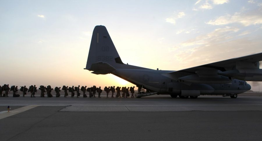 Marines and sailors with Marine Expeditionary Brigade – Afghanistan load onto a KC-130 aircraft on the Camp Bastion flightline, Oct. 27, 2014. The Marine Corps ended its mission in Helmand province, Afghanistan, the day prior and all Marines, sailors and service members from the United Kingdom withdrew from southwestern Afghanistan.
