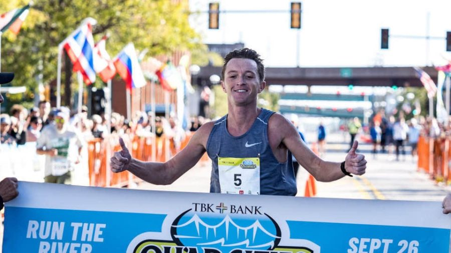 Tyler Pence crossing the finish line | Photo Credit: Pence Talks Marathon Win, Looking At The Positives [INTERVIEW] · NewsKudo